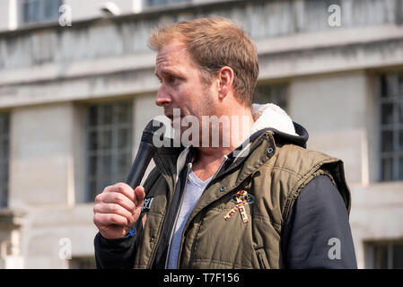 Dan Richardson, Compere, Actor, Ambassador for Born Free, at the London March Against Trophy Hunting and Extinction opposite Downing Street, London. - Stock Image