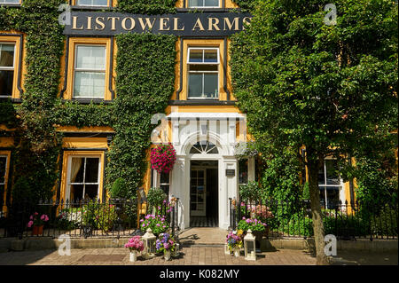 Ivy covered building façade of the Listowel Arms Hotel in the centre of Listowel, County Kerry, Ireland - Stock Image