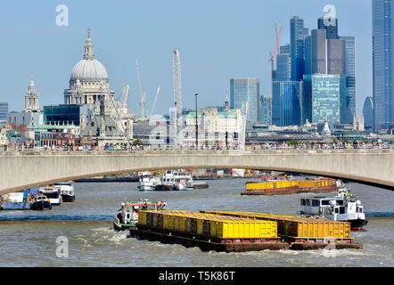 London, England, UK. Thamestug ('Recovery') pulling freight containers under Waterloo Bridge on the River Thames, towards St Paul's Cathedral - Stock Image