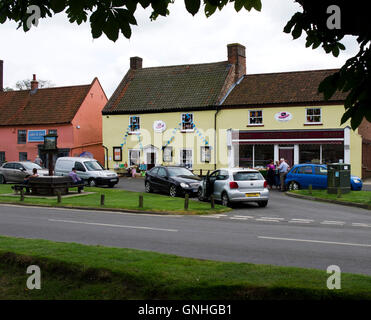 Pentney House on Burnham Market gree looks like a general store but has a specialised variety of hats for sale - Stock Image