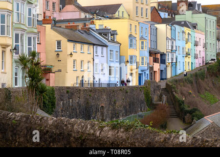 Colorful houses in the coastal town of Tenby in Carmarthen Bay, Pembrokeshire on the south coast of Wales in the United Kingdom. - Stock Image