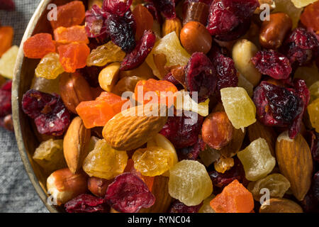 Healthy Dried Fruit and Nut Mix with Almonds Raisins Cranberries - Stock Image