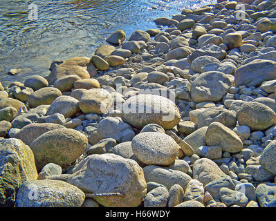 River Stones on hot sunny day - Stock Image