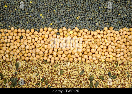 Selection of Mixed Healthy Seeds and Pulses Green Lentils Chickpeas Chia Pumpkin and Sunflower Seeds for Vegetarian and Vegan Diets - Stock Image