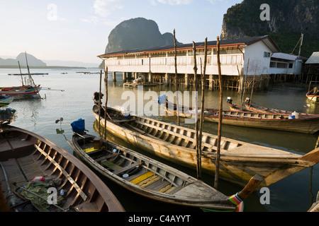 Thailand, Phang-Nga, Ko Panyi.  Long-tail fishing boats at the Muslim village of Ko Panyi. - Stock Image