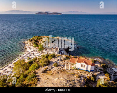 The famous beach in Thasos called Karnagio shortly before sunset in Thasos, Greece - Stock Image