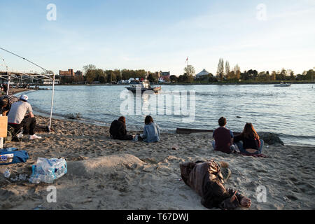 VANCOUVER, BC, CANADA - APR 20, 2019: A homeless man sleeping on the beach at the 420 festival in Vancouver. - Stock Image