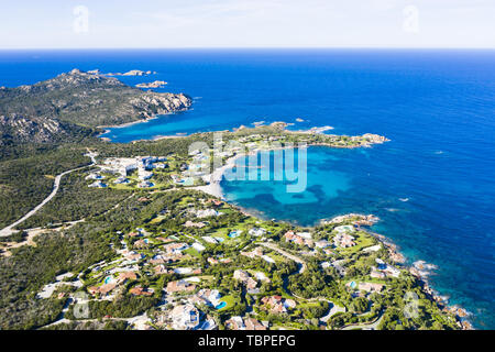 View from above, stunning aerial view of the Romazzino Beach bathed by a beautiful turquoise sea. Costa Smeralda (Emerald Coast) Sardinia, Italy. - Stock Image