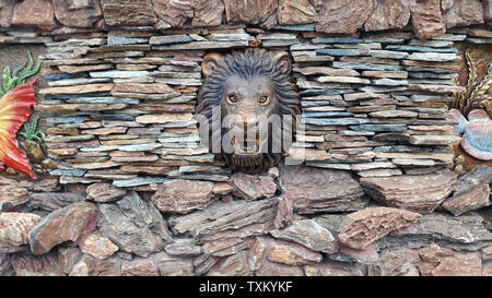 Lion Head Statue wall - Stock Image