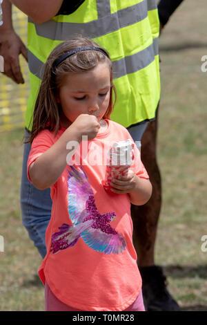 Small girl eating an ice cream - Stock Image