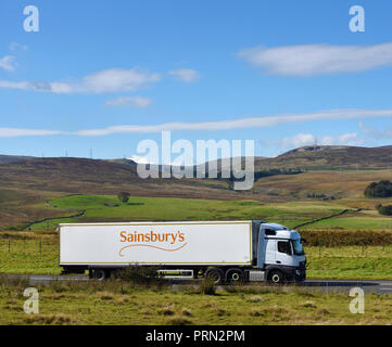 Sainsbury's Supermarkets HGV. M6 Northbound carriageway, Shap, Cumbria, England, United Kingdom, Europe. - Stock Image