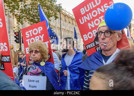 London, UK. 20th October 2018. Marchers walk past down Whitehall at the end of the People's Vote March calling for a vote to give the final say on the Brexit deal or failure to get a deal. They say the new evidence which has come out since the referendum makes it essential to get a new mandate from the people to leave the EU. With so many on the march the crowding meant many failed to reach Parliament Square and came to a halt in Whitehall. Peter Marshall/Alamy Live News - Stock Image