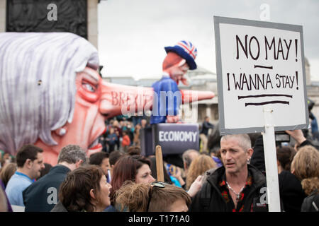 Theresa May puppet head amongst marchers, People's Vote March, London, England - Stock Image
