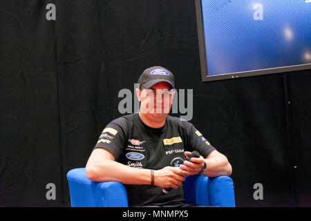 Stunt driver, Paul Swift  being interviewed at the Lecture Theatre,  during the  London Motor Show 2018. - Stock Image