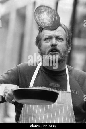 Shrove Tuesday: Hotelier Philip Artingstall breaking his own world Record with 266 Pacake Flips in 2 minutes. 25th February 1990 P29173 - Stock Image