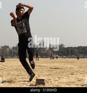 Cricket bowler, Kathmandu - Stock Image