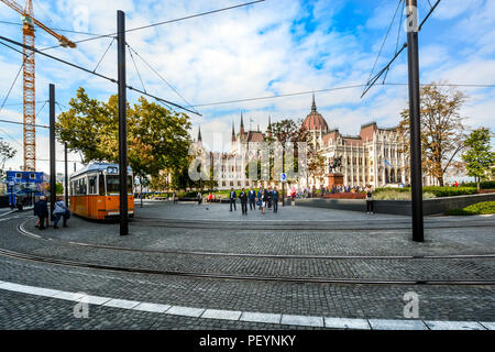 A group of Hungarian business people leave the Parliament building towards train tracks in the government center of Budapest, Hungary - Stock Image