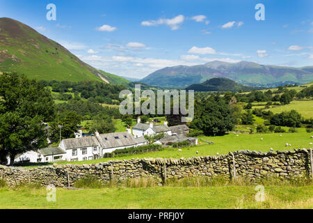 Newlands valley Cumbria, looking north over the hamlet of Littletown, towards Swinside and the distant mountain of Skiddaw with Rowling End rising to  - Stock Image