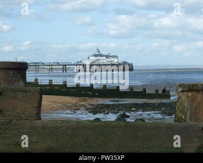 Eastbourne beach and pier, on a summer's day, not long after the fire. - Stock Image