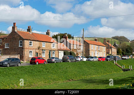 Cars parked in the village of Bishop Wilton, East Yorkshire, England UK - Stock Image