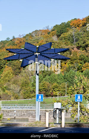 Electric Vehicle Charge Station, Solar Array Panels, identified as 'Solar Voltaic Flair',  17 ft. in diameter, weighing approx. 1200 lbs. - Stock Image