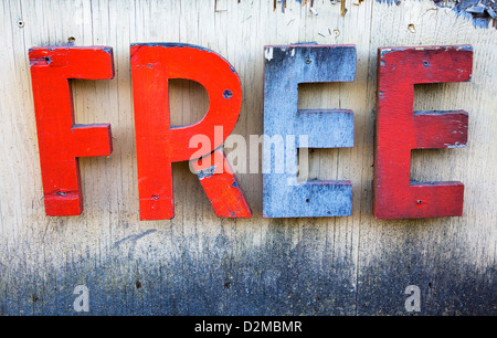 free sign in letters on side of large wooden box - Stock Image
