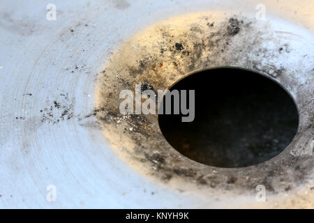 The ash remaining from the smoked cigarettes is visible in the steel ashtray. - Stock Image