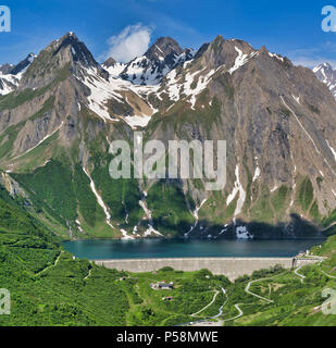 Dam and Lake of Morasco with great mountain on the background seen in a beautiful day of spring season, Riale - Formazza Valley, Piedmont, Italy - Stock Image