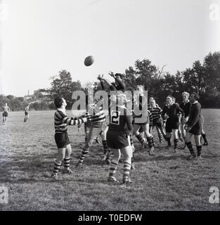 1964, amateur rugby match, England, UK, players challenging for the ball at a line-out. - Stock Image