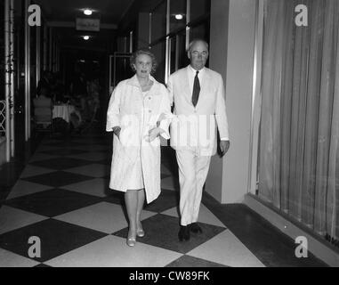 Mr & Mrs Ogden Phipps at Lillian Phipps' gallery opening, Dec. 18,1965,Palm Beach, FL. Mrs Phipps is the - Stock Image