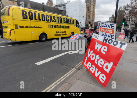 London, UK. 15th January 2019. The 'Bollocks to Brexit' bus drives post Leave Means Leave protesters at Parliament. Groups against leaving the EU, including SODEM, Movement for Justice and In Limbo and Brexiteers Leave Means Leave and others protest opposite Parliament as Theresa May's Brexit deal was being debated.  While the two groups mainly kept apart, a small group, some in yellow jackets came to shout insults at pro-EU campaigners, while police tried to keep the two groups separate. Credit: Peter Marshall/Alamy Live News - Stock Image