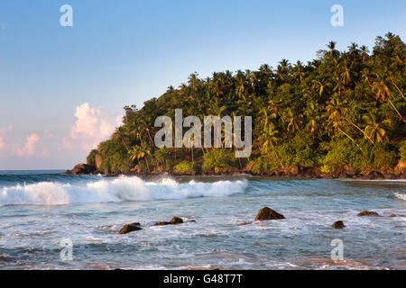 Sri Lanka, Mirissa, early morning waves at western end of beach - Stock Image