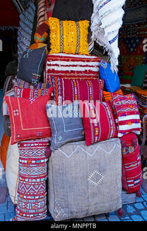 A display of colourful traditioal cushions In the Souk the Street Market at Jemaa el Fnaa in the Medina Old City in the centre of Marrakech in Morocco - Stock Image