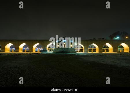 Illuminated bridge over dried Zayandeh river, Isfahan, Iran - Stock Image