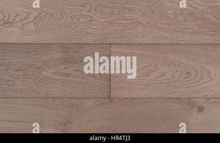Top view photo of old vintage rustic smoked and white oiled german oak wood floor boards with rough texture - Stock Image