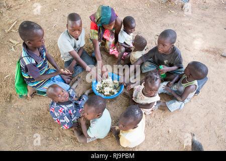 Kisambo Village, Yako, Burkina Faso, 28th November 2016; Children a given a meal rich in cooked moringa. - Stock Image