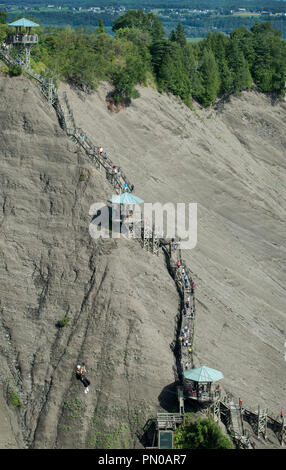 The 487-step staircase and person on the 300 metres zip line at Montmorency Falls, (7.5 miles) from downtown Québec City. - Stock Image