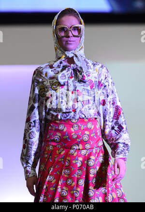 Southampton, England, UK,  8th June 2018. Solent university tonight held its BA (HONS) Fashion graduate show in Southampton to showcase the skills and imagination of the final year students. The collection of Jade Axam ( pictured) takes its inspiration from a tongue and cheek look at topical debates such as Brexit and the formulation of British identity. This collection focuses on the Queens six Corgis and the royal family. credit Paul Watts/ Alamy Live News Credit: PBWPIX/Alamy Live News - Stock Image