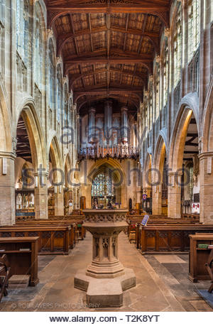 Interior of the Holy Trinity Church, location of William Shakespeare's tomb, with winter sun streaming through the clerestorey windows. - Stock Image