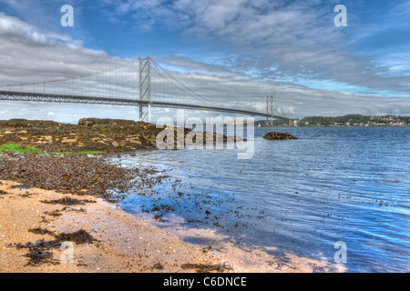Hdr image of the World famous Forth Road Bridge spanning the Firth of Forth, Scotland. - Stock Image