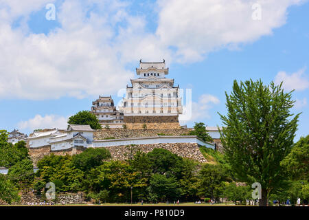 Low angle shot of Himeji Castle with cloudy sky in the background. In Hyogo Prefecture, Japan. - Stock Image