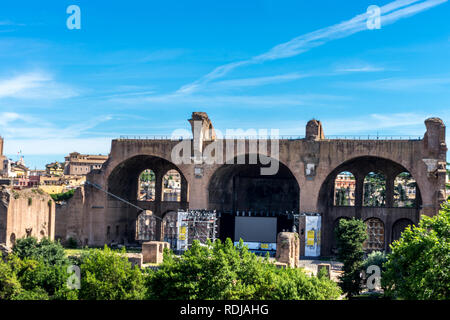 Rome, Italy - 24 June 2018: The ancient ruins of Basilica of Maxentius at the Roman Forum in Rome. Famous world landmark - Stock Image