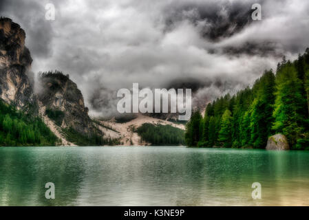 Pragser Wildsee in the morning with the clouds in front of the mountains, Trentino-Alto Adige, Sud Tirol, Italy - Stock Image