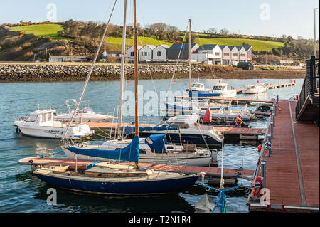 Bantry, West Cork, Ireland. 3rd Apr, 2019. The Bantry Marina basks under a clear sky. The day has started bright but with strong northerly winds. This afternoon will see prolonged showers with highs of 6 to 9°C. Credit: Andy Gibson/Alamy Live News. - Stock Image