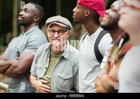 Portrait smiling senior man with mens group - Stock Image