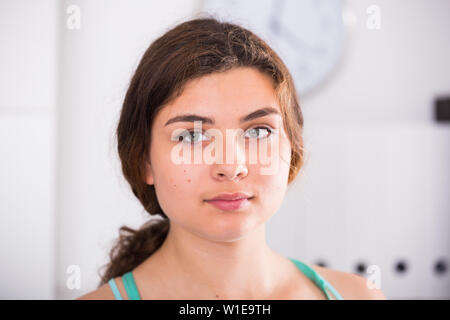 Portrait of trainee woman which is working in office. - Stock Image