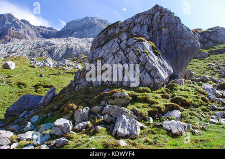 Large protruding rock in the alpine mountain valley of Solalex in the Swiss Alps in Vaude, Switzerland - Stock Image