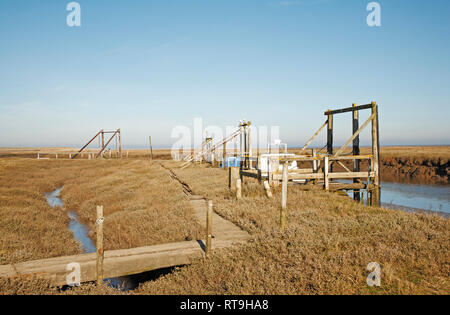 A view of the quayside and harbour in salt marshes on the North Norfolk coast at Thornham, Norfolk, England, United Kingdom, Europe. - Stock Image