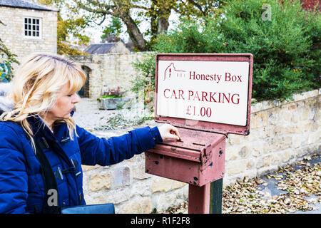 Honesty box car park parking donation, using honesty box, car parking honesty box, using honesty box, car park honesty box, Yorkshire, uk, England - Stock Image