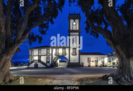 Ribeira Grande, Azores, Portugal. Colonial building of town hall illuminated at dusk - Stock Image